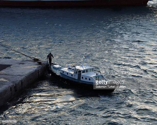 high angle view of man standing on boat in sea - solomon turkel stock pictures, royalty-free photos & images