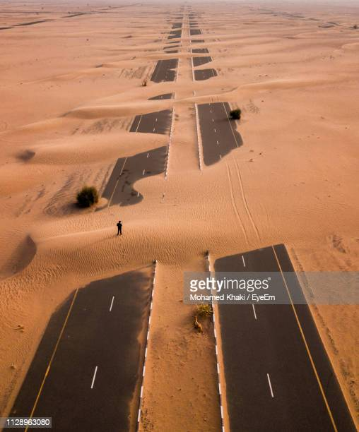 High Angle View Of Man Standing On Desert