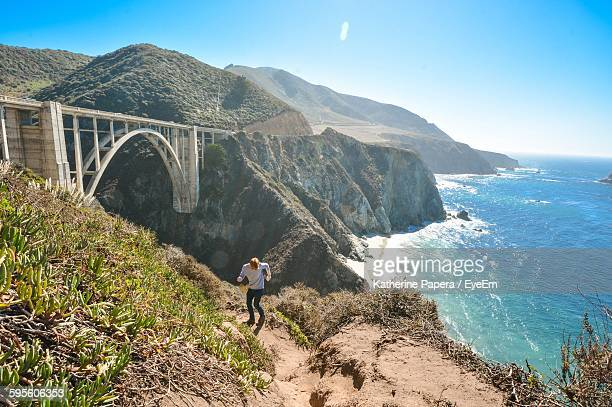 High Angle View Of Man Standing On Hill By Bixby Creek Bridge