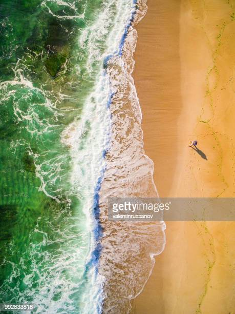 high angle view of man standing on the beach - bulgaria stock pictures, royalty-free photos & images