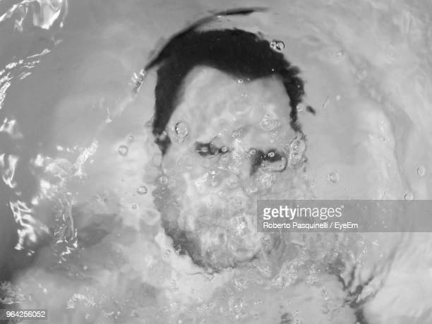 High Angle View Of Man Swimming In Water