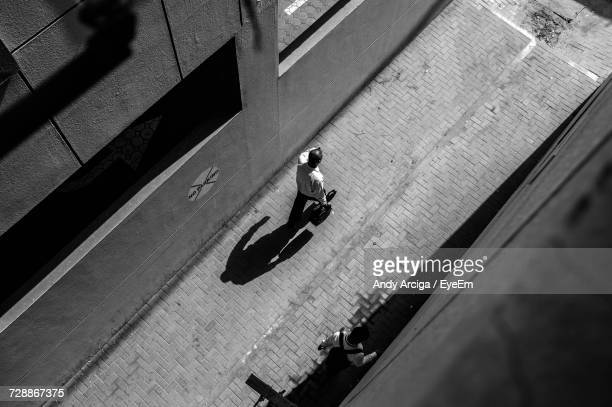 High Angle View Of Man Walking In Alley