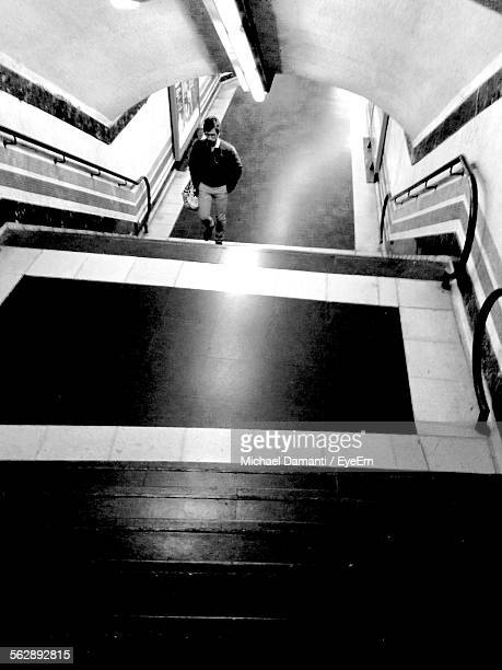 high angle view of man walking in staircase of subway station - michael damanti fotografías e imágenes de stock