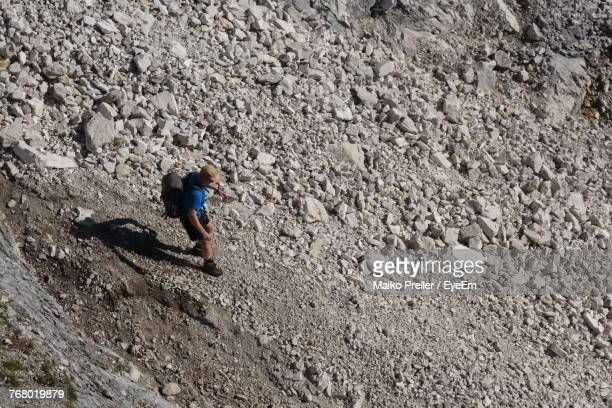 High Angle View Of Man Walking On Stones