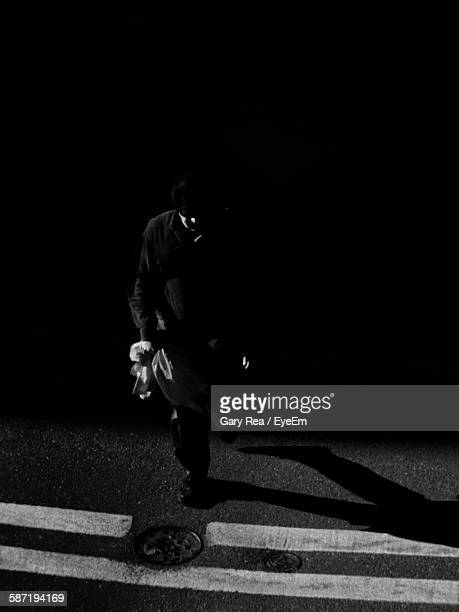 High Angle View Of Man Walking On Street In City