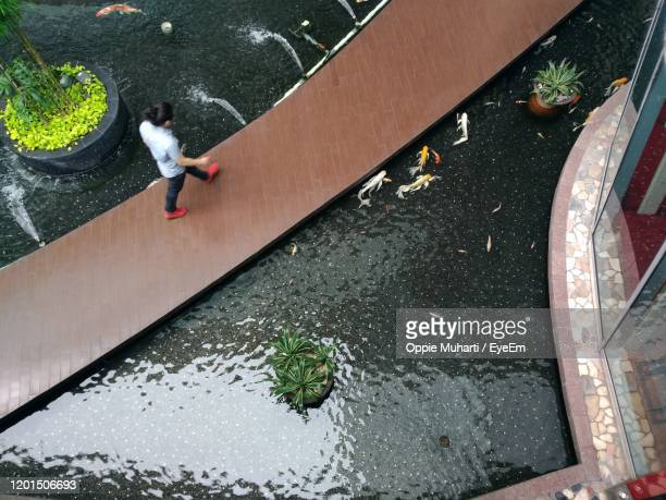 high angle view of man walking - oppie muharti stock pictures, royalty-free photos & images
