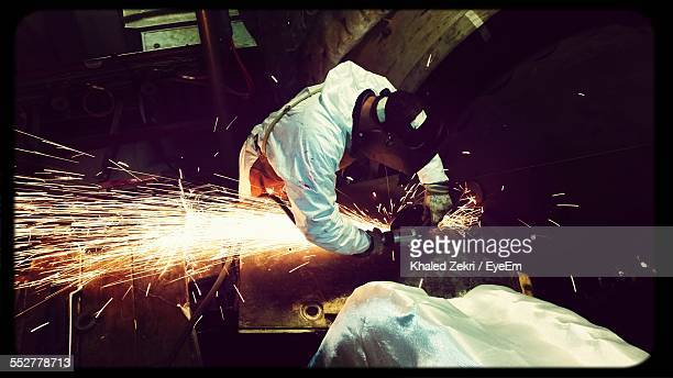 High Angle View Of Man Welding In Garage