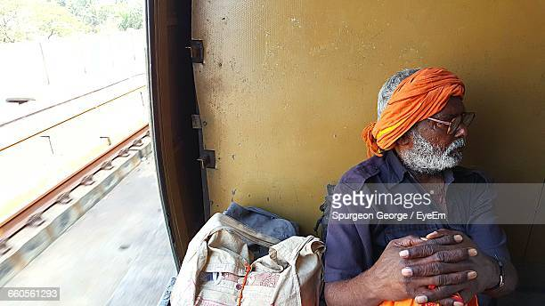 High Angle View Of Man With Luggage Traveling In Train
