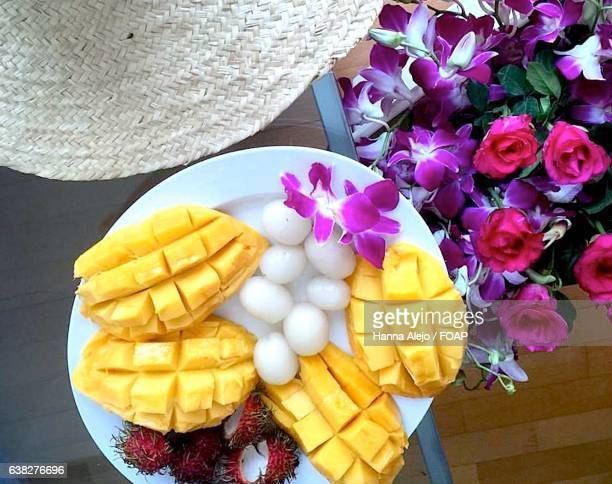 High angle view of mango fruits in plate