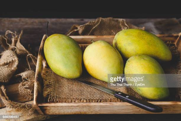 High Angle View Of Mangoes In Basket On Table