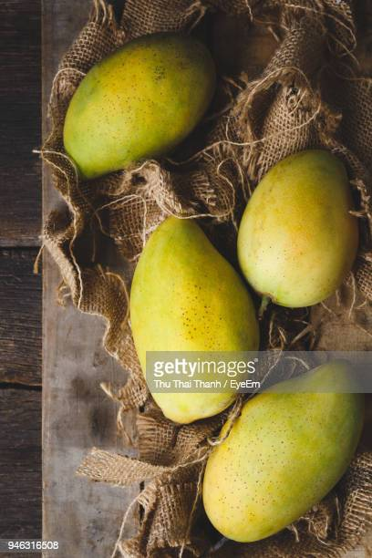 High Angle View Of Mangoes On Table