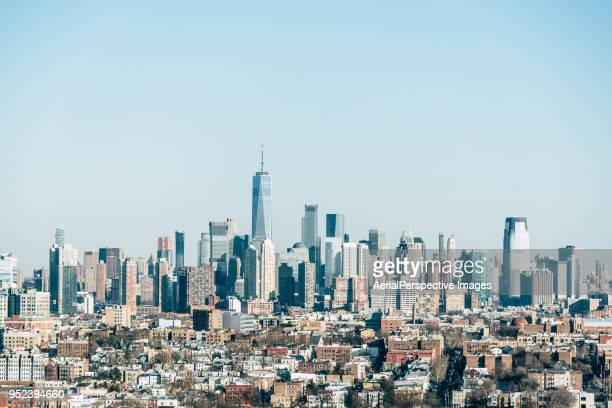 high angle view of manhattan skyline - wall street stock-fotos und bilder