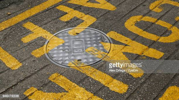 High Angle View Of Manhole On Road