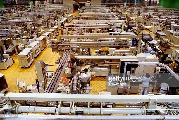 High angle view of manual workers working in a cigarette factory, Richmond, Virginia, USA
