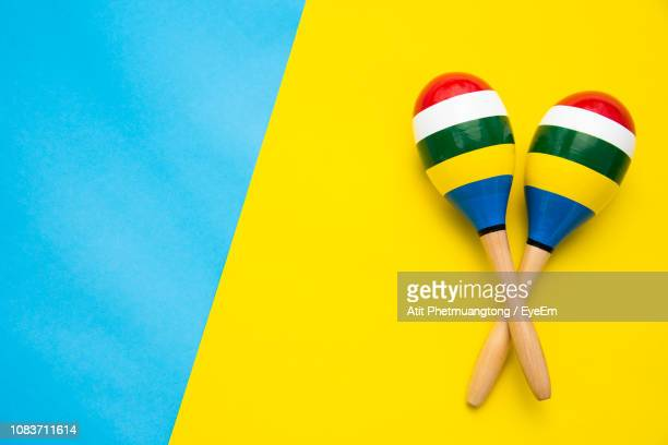 high angle view of maracas on colored background - maraca stock photos and pictures