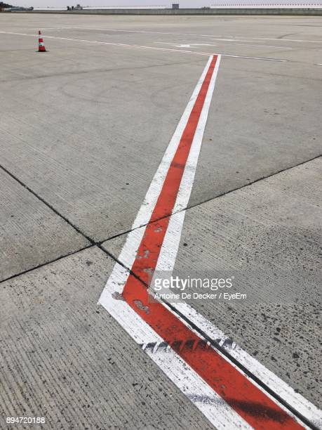 High Angle View Of Marking On Road At Airport