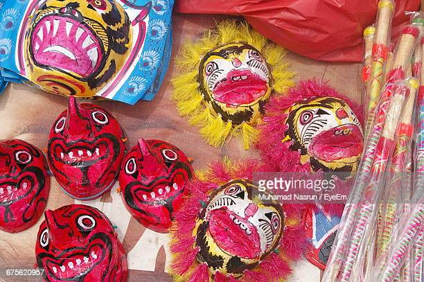 high angle view of masks for sale - muhamad nasrun stock pictures, royalty-free photos & images