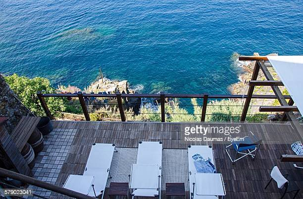High Angle View Of Massage Beds On Patio By Sea