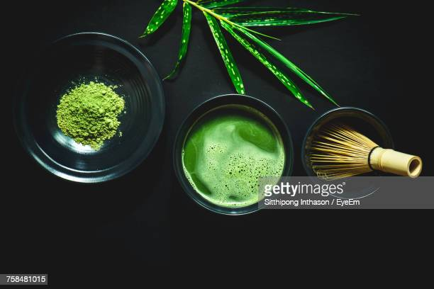 high angle view of matcha tea against black background - ceremony stock pictures, royalty-free photos & images