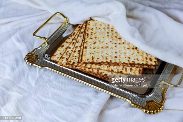 high angle view of matzo in plate on table - matzah stock pictures, royalty-free photos & images