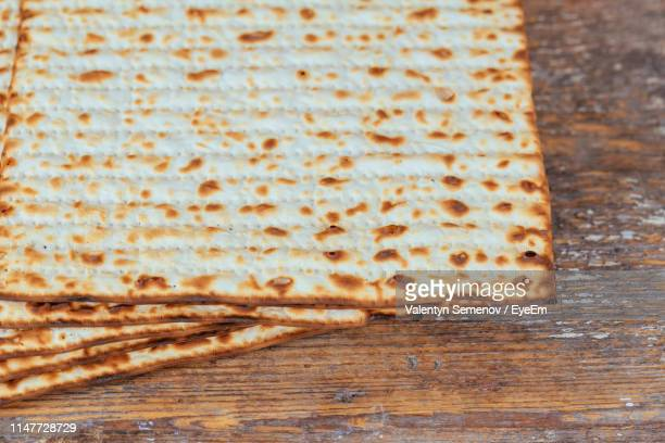 high angle view of matzo on wooden table - matzah stock pictures, royalty-free photos & images