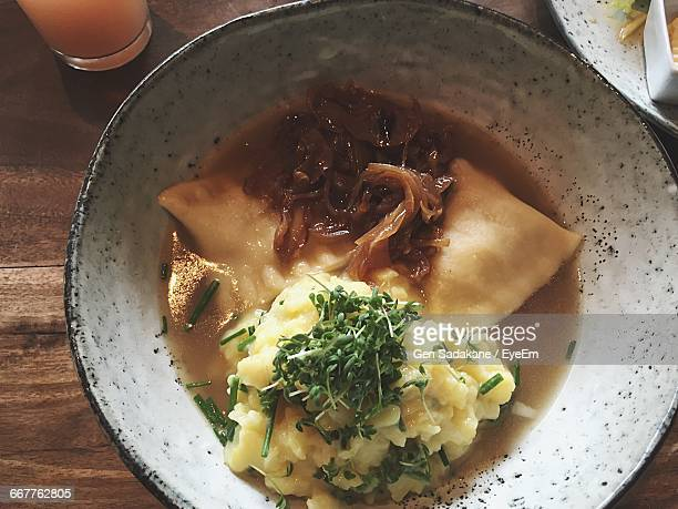 High Angle View Of Maultaschen Served In Plate On Table