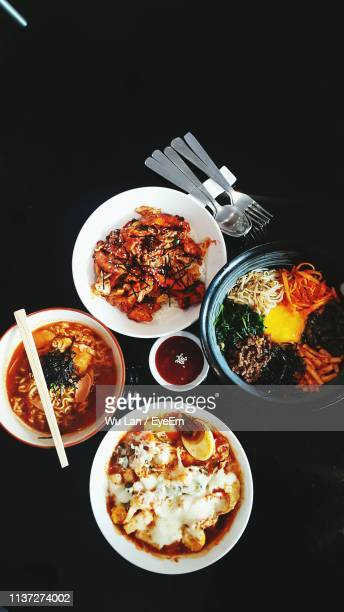 high angle view of meal served on black background - east java province stock pictures, royalty-free photos & images