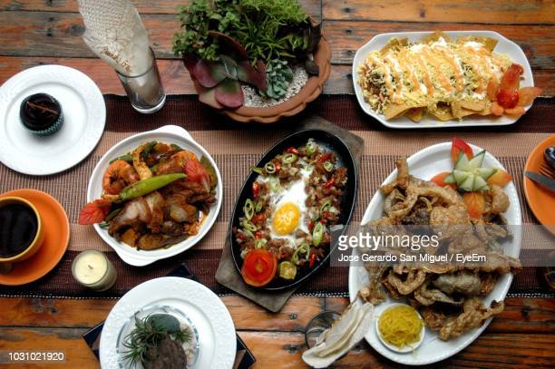 high angle view of meal served on table - philippines stock pictures, royalty-free photos & images