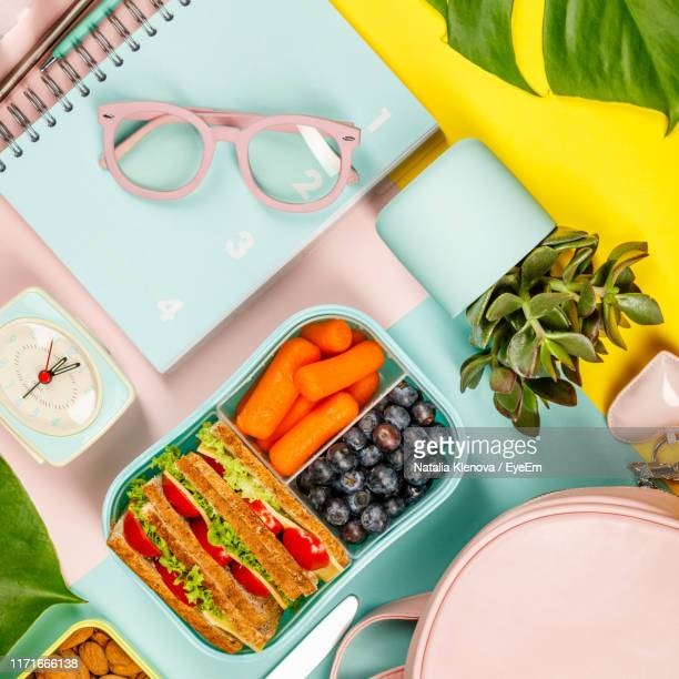 high angle view of meal with books on table - lunch box stock pictures, royalty-free photos & images