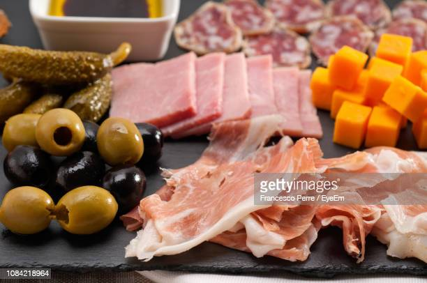 High Angle View Of Meat And Olives With Cheese