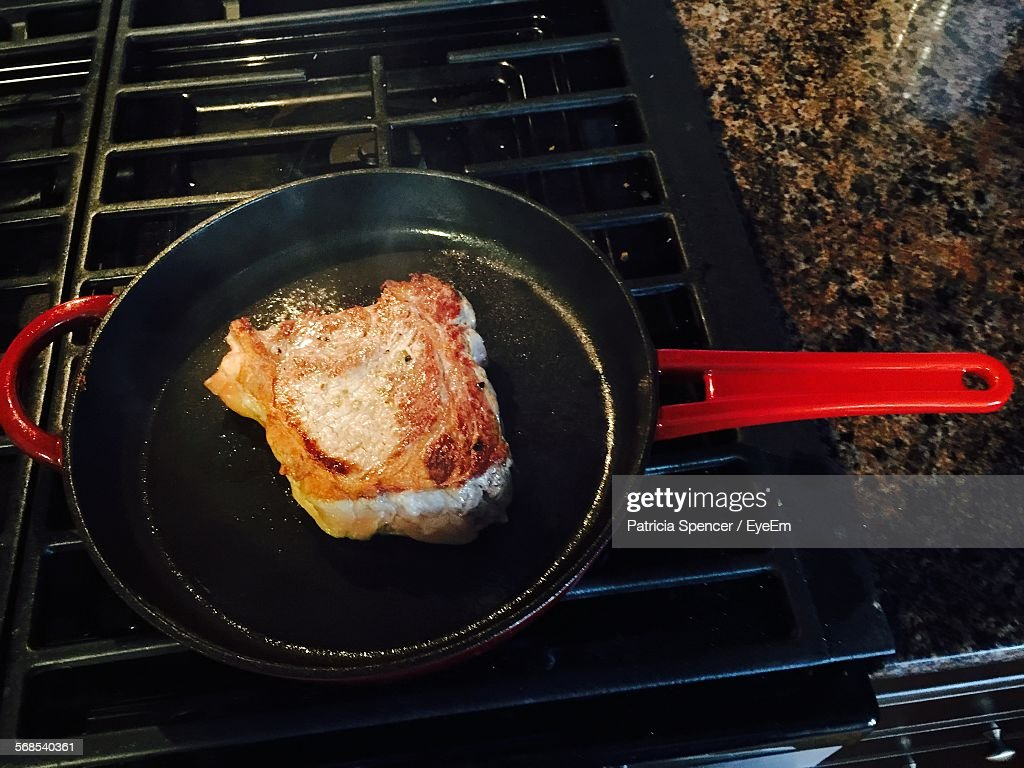 High Angle View Of Meat In Frying Pan : Stock Photo
