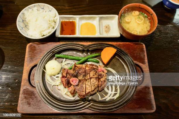 High Angle View Of Meat In Plate On Tray Over Table