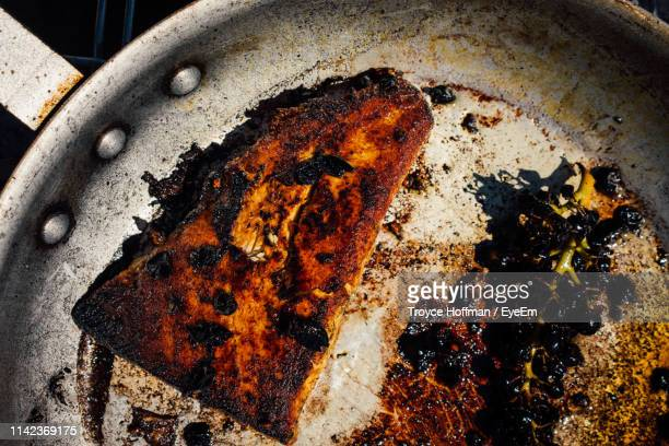 high angle view of meat on barbecue grill - burnt stock pictures, royalty-free photos & images