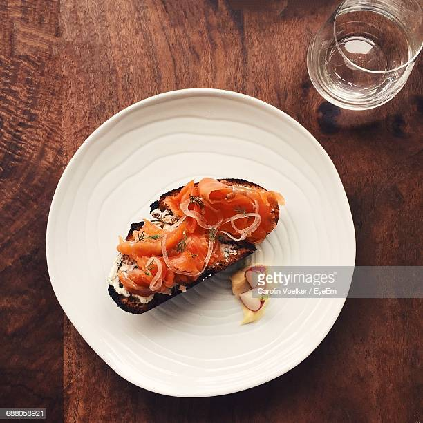 high angle view of meat served in plate on table - salmone affumicato foto e immagini stock