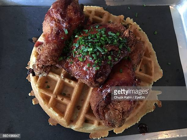 high angle view of meat with waffle - chicken and waffles stock photos and pictures