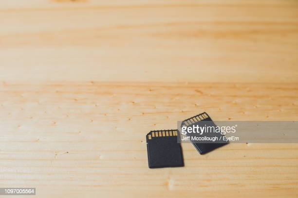 High Angle View Of Memory Cards On Wooden Table