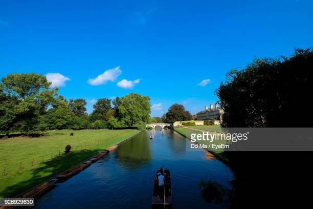 high angle view of men on boat sailing in canal during sunny day - cambridge cambridgeshire imagens e fotografias de stock