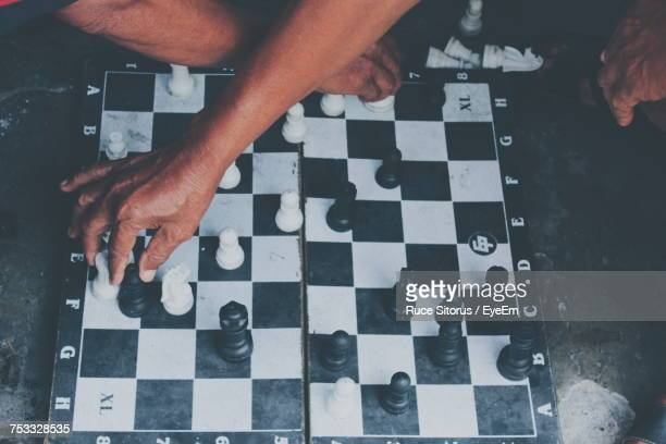 high angle view of men playing on table - reality kings stock pictures, royalty-free photos & images