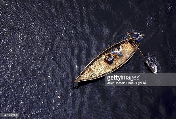 high angle view of men sailing boat on buriganga river - bangladesh stock pictures, royalty-free photos & images