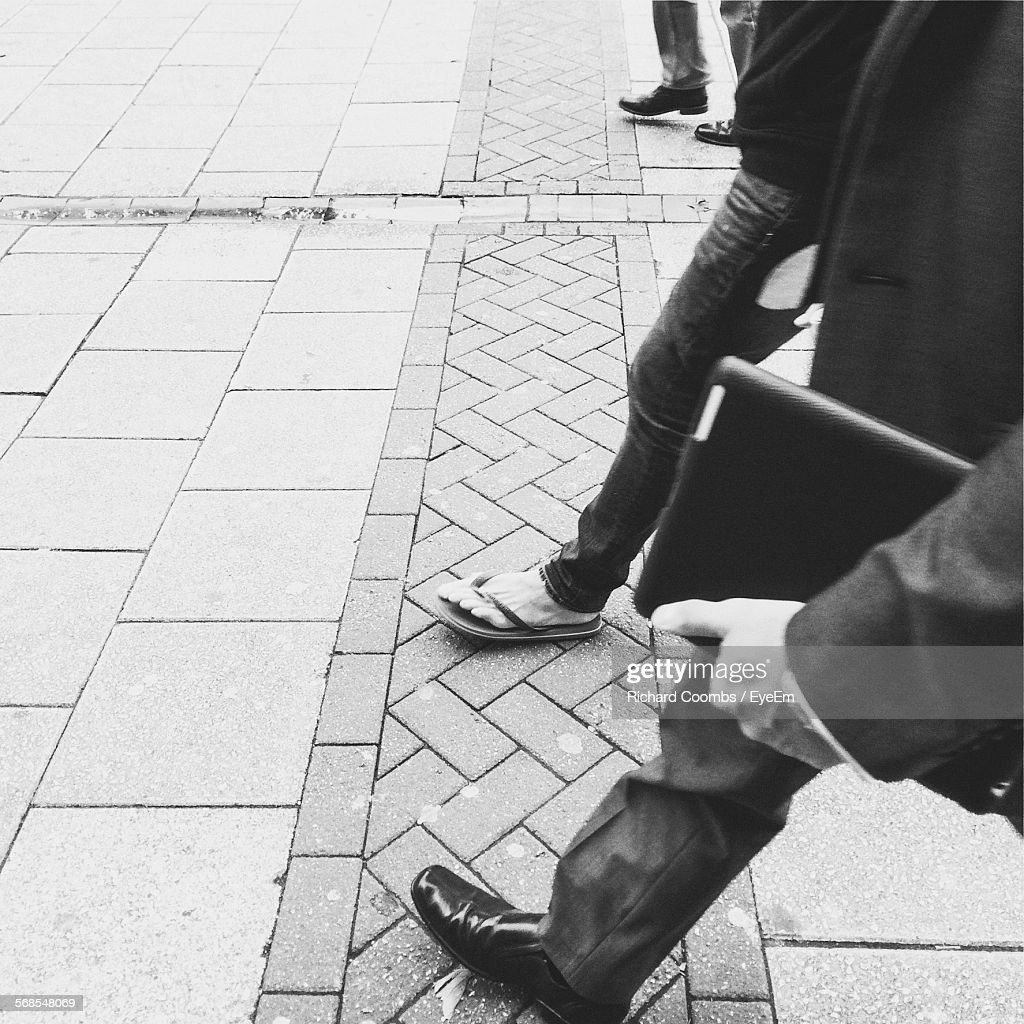 High Angle View Of Men Walking On Street : Stock Photo