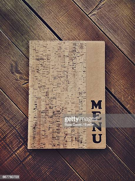 high angle view of menu on wooden table - menu stock pictures, royalty-free photos & images