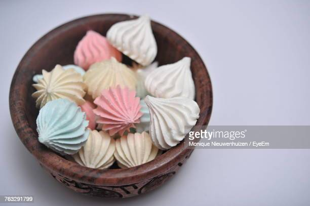 High Angle View Of Meringues In Bowl On White Background