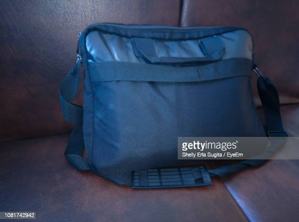 High Angle View Of Messenger Bag On Sofa At Home