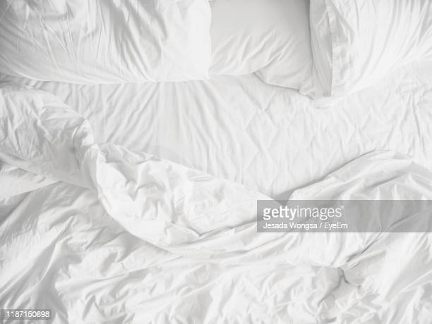 high angle view of messy bed - sheet bedding stock pictures, royalty-free photos & images