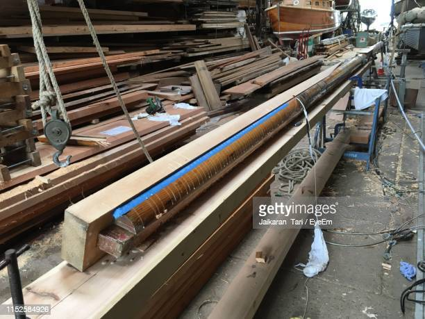 high angle view of messy workshop - tari stock pictures, royalty-free photos & images