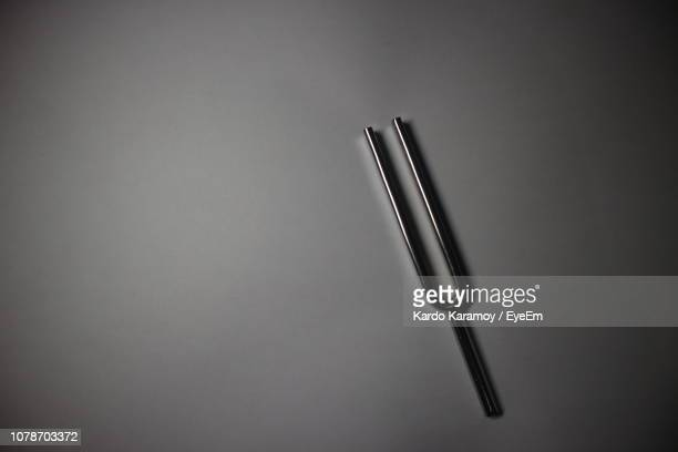 high angle view of metal against gray background - vignette stock photos and pictures