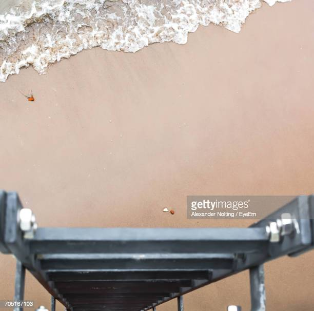 High Angle View Of Metallic Ladder At Beach