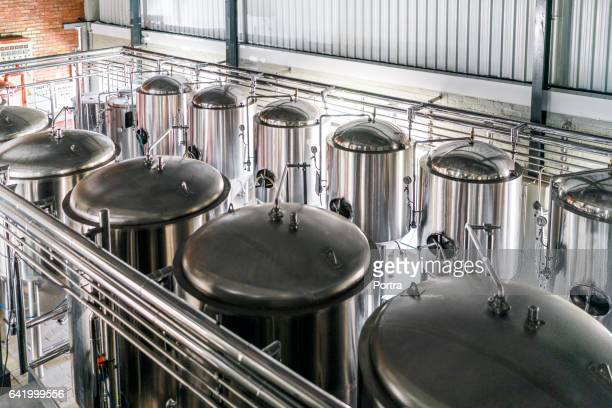 high angle view of metallic vats in brewery - storage tank stock photos and pictures