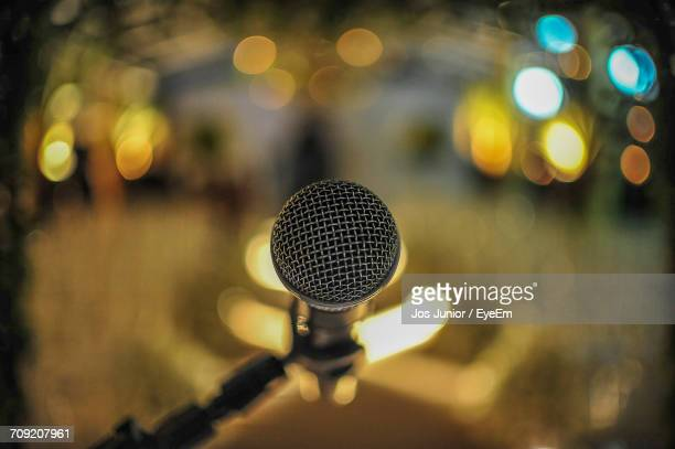 High Angle View Of Microphone In Illuminated Room