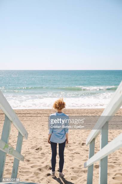 High Angle View Of Mid Adult Woman Standing By Footpath At Beach
